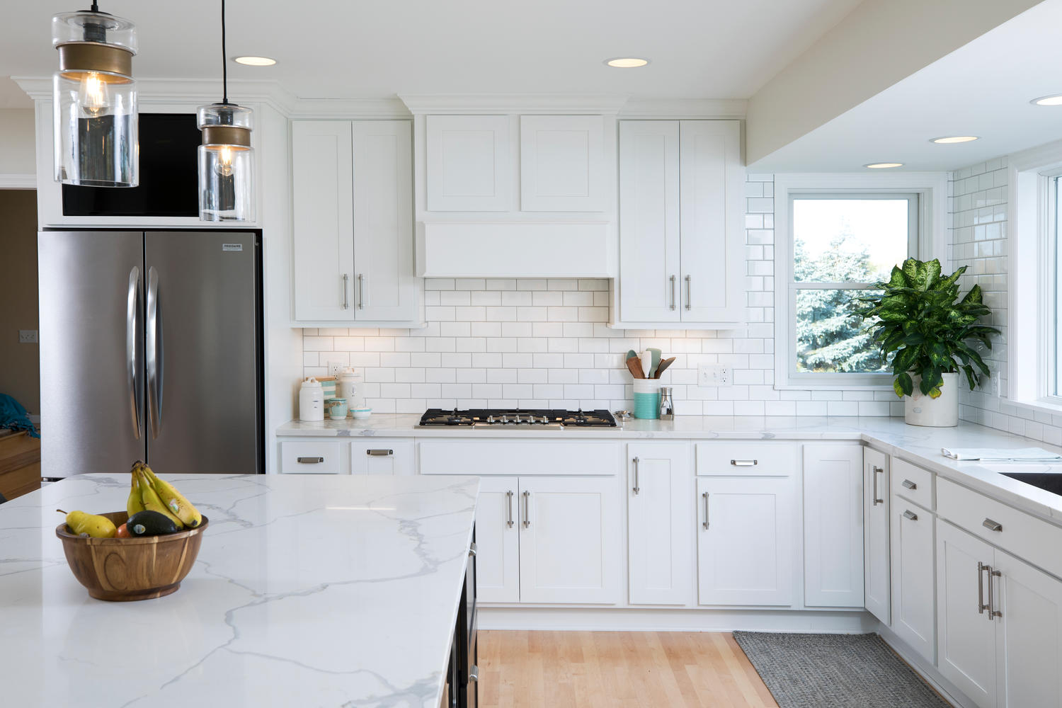 Kitchen with white cabinetry and quartz countertops
